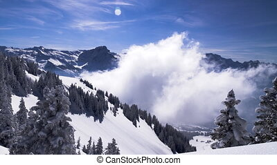 A living winter postcard: clouds form in a valley timelapse...
