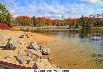 Fall Lakeshore - Boat launch harbor framed by fall foliage...