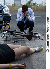 Car bike accident - A man crying after hitting a woman on a...