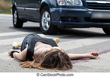 Dead woman on the street - A dead woman in blood after a car...