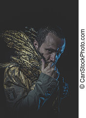 Fallen angel, man beard and suit made with golden wings