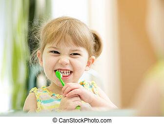funny child girl brushing teeth