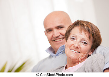 old woman smiling happily with his husband - old woman and...