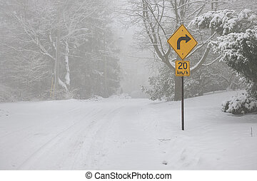 Right turn warning sign on winter road - Winter road covered...