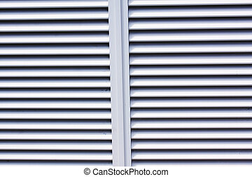 louvered aluminium shutters showing some paint coming off