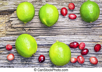 Citrus lime fruits with cranberries