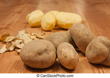 Potatos - White peeled potatos. Potato peelings