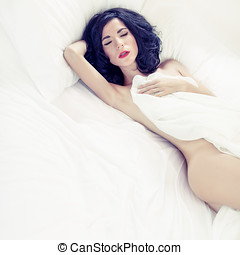 sensual sexy woman sleeping in white bed