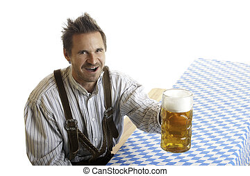 Bavarian man with Oktoberfest beer stein Mass - Close-up of...