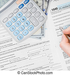 Filling out 1040 US Tax Form - view from top
