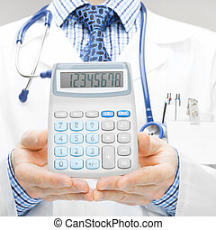 Doctor holdling calculator - studio shoot