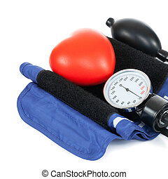 Blood pressure measuring tools with red toy heart
