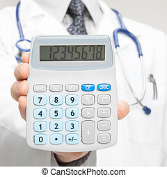 Doctor holding calculator - closeup shot
