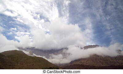 Clouds in the mountains - Clouds form on a mountains...