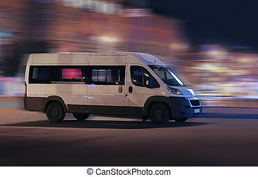 minibus moves on the night city - white minibus moves on the...