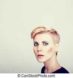 woman with short stylish hairstyle - fashion portrait of the...