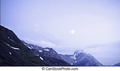 Moonrise in the alps timelapse - the full moon rises behind...