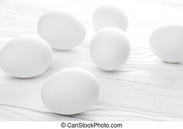 Many white eggs on the white - Many white eggs on the wooden...