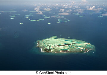 Maldives - Aerial view of Maldives atoll and reefs seen from...