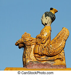 beautiful ceramic figurine from traditional chinese roof...