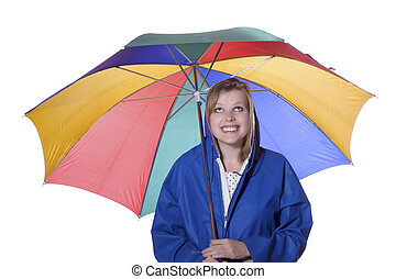women with umbrella in a blue rain coat - young smiling...