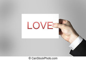 hand holding card love - hand holding white card love...