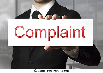 businessman showing sign complaint - businessman in black...