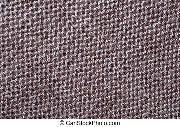 the knitted fabric - decorative background of the knitted...