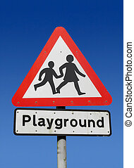 Red playground road sign.