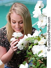 Lovely Smiling Blond Lady and Flowers - Pretty young lady...
