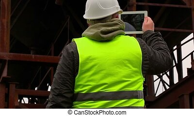 Engineer filmed with tablet PC