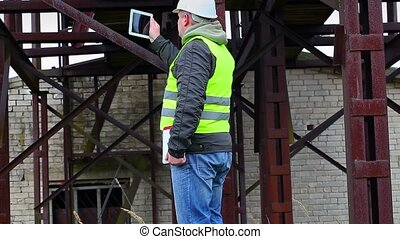 Engineer filmed with tablet PC in factory