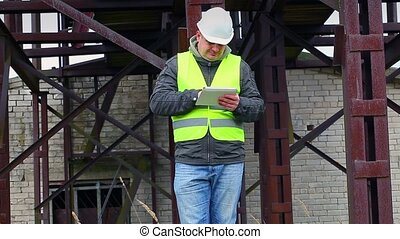 Engineer with tablet PC in factory