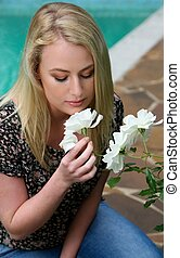 Lovely Blond Lady and Flowers - Pretty young lady smelling...