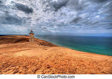 Lighthouse in the sand dunes of Rubjerg Knude in Denmark