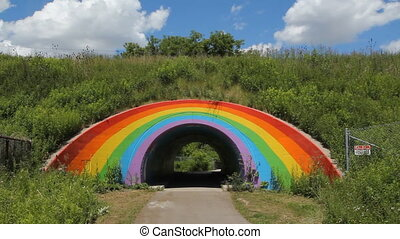 Rainbow tunnel. Timelapse clouds.