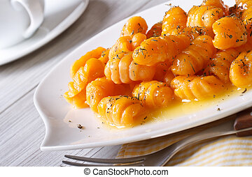 Tasty yellow pumpkin gnocchi with butter, horizontal