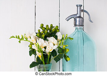 Vintage home decor, ancient turquoise siphon, freesias...