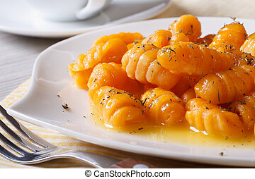 Delicious pumpkin gnocchi with butter and spices. Horizontal