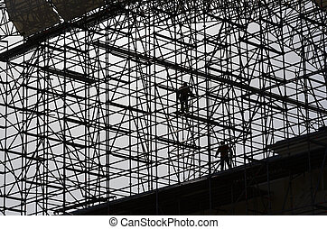 workers assemble metal construction