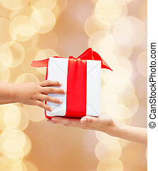 close up of child and mother hands with gift box - holidays,...
