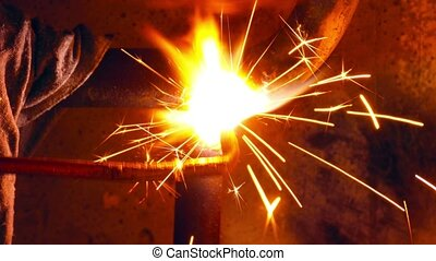 Lighting Welding Torch - Welder at work cooking and water...