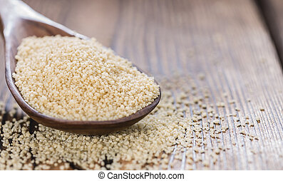 Couscous (close-up shot) on an old wooden table