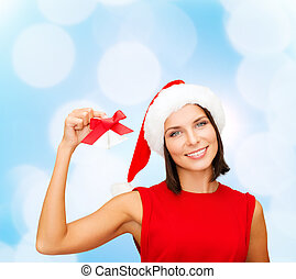 smiling woman in santa hat with jingle bells - christmas,...