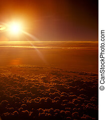 Sunset over a clouds. - View of sunset over a clouds from...