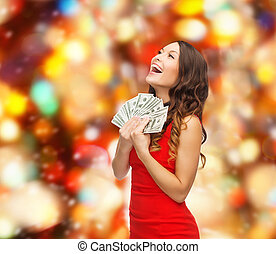 woman in red dress with us dollar money - christmas,...