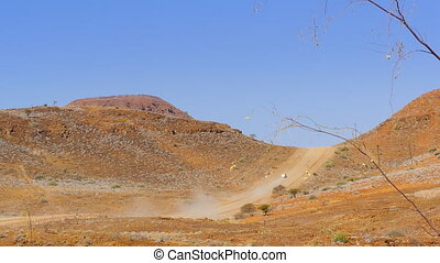car crossing a mountain pass africa - a car drives into the...