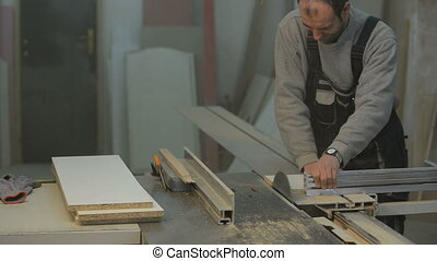 carpenter cutting the wooden panel