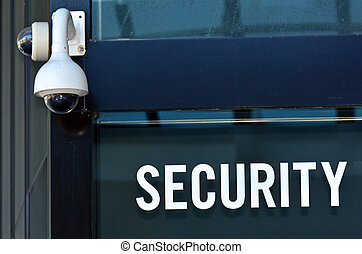 Security Camera and sign on a building wall Concept photo...