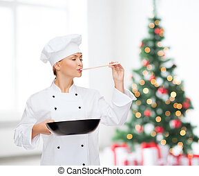 smiling female chef with pan and spoon - cooking, holidays,...
